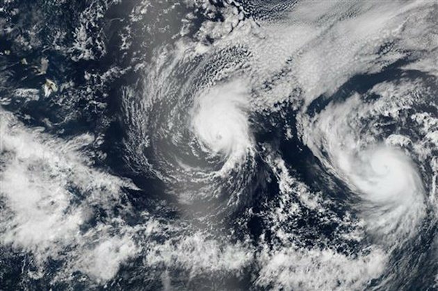 this-aug-5-2014-satellite-image-provided-by-nasa-shows-two-tropical-pacific-ocean-hurricanes-iselle-at-center-and-julio-at-right-bearing-down-on-hawaii-top-left-hurricane-iselle-is-expected-to-reach-hawaii-thursday-night-aug-7-2014-tracking-close-behind-it-is-hurricane-julio-which-strengthened-early-thursday-into-a-category-2-storm