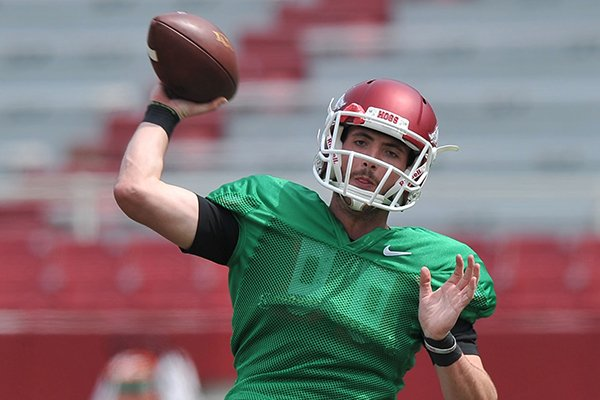arkansas-quarterback-brandon-allen-throws-a-pass-during-practice-saturday-april-12-2014-at-razorback-stadium-in-fayetteville