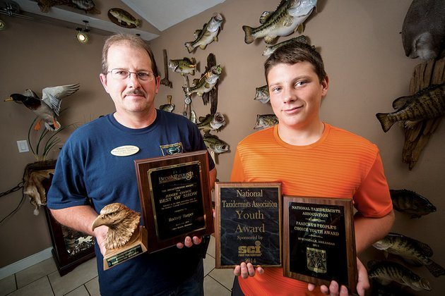 rodney-harper-and-his-son-jared-are-shown-with-some-of-the-awards-they-have-recently-won-in-taxidermy-competitions