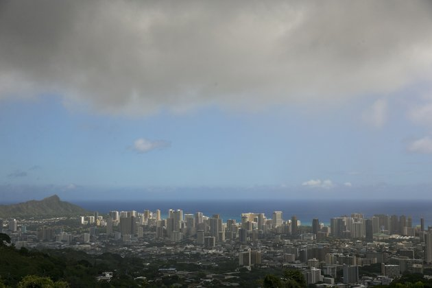 clouds-hang-over-honolulu-seen-from-the-top-of-tanalus-drive-on-thursday-aug-7-2014-with-iselle-hawaii-is-expected-to-take-its-first-direct-hurricane-hit-in-22-years-tracking-close-behind-it-is-hurricane-julio