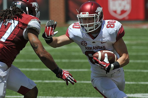Arkansas receiver Drew Morgan runs after a catch during the Red-White Game on Saturday, April 26, 2014 at Razorback Stadium in Fayetteville.