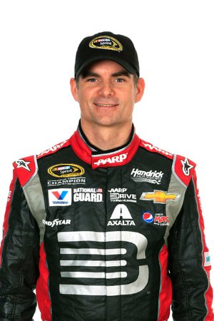 "Jeff Gordon shouted ""Oh, yeah boys! Yoo Hoo!"" over his radio, then punched his right arm skyward when he emerged from his No. 24 Chevrolet as his resurgent season continues."
