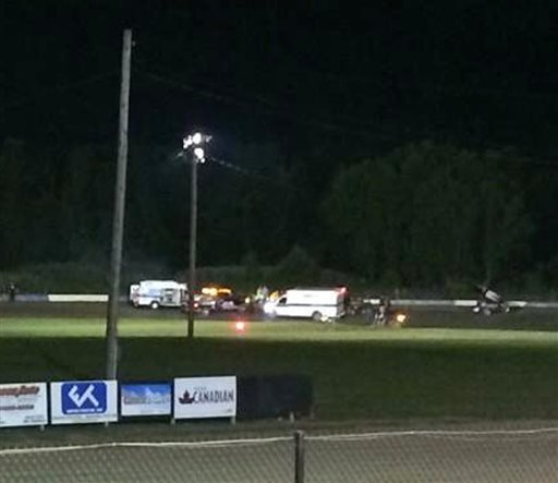this-image-provided-by-logan-messerly-shows-ambulances-on-the-scene-at-canandaigua-motorsports-park-on-saturday-aug-9-2014-in-canandaigua-ny-authorities-are-investigating-a-serious-crash-that-injured-one-person-at-a-new-york-dirt-track-where-tony-stewart-was-racing-on-the-eve-of-a-nascar-race