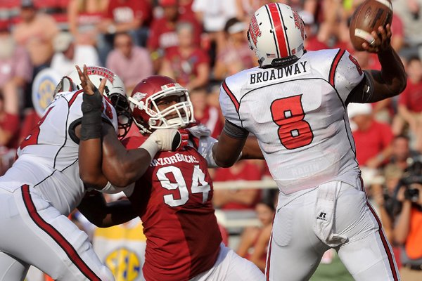 Arkansas defensive end Taiwan Johnson puts the pressure on the quarterback during the game against the Louisiana Ragin' Cajuns, Saturday, Aug. 31, 2013, at Razorback Stadium in Fayetteville.