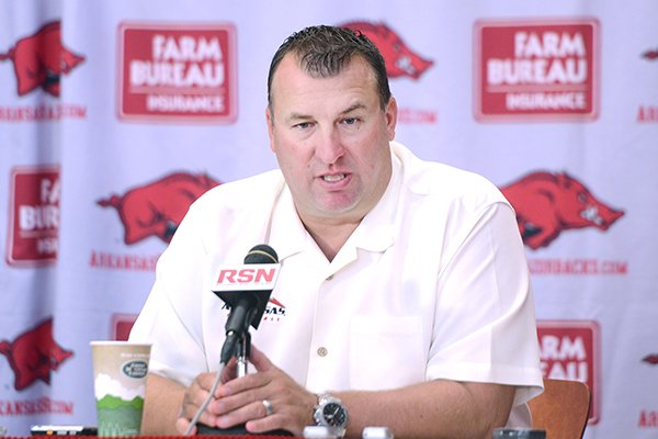 Arkansas head football coach Bret Bielema answers questions from the media Sunday, Aug. 10, 2014, at Fred Smith Football Center in Fayetteville.