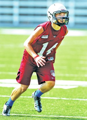STAFF PHOTO JASON IVESTER Gavin Schmidt, Springdale High junior safety, runs Wednesday during practice at Jarrell Williams Bulldog Stadium.