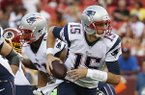 New England Patriots quarterback Ryan Mallett scrambles out of the pocket during the first half of an NFL football preseason game against the Washington Redskins in Landover, Md., Thursday, Aug. 7, 2014. (AP Photo/Alex Brandon)