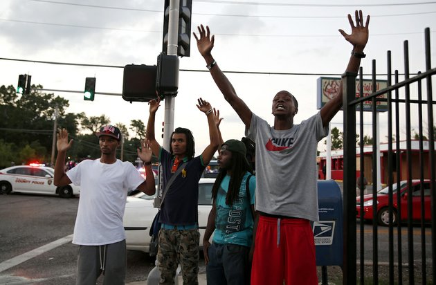 protesters-yell-at-police-monday-aug-11-2014-in-ferguson-mo-the-fbi-opened-an-investigation-monday-into-the-death-of-18-year-old-michael-brown-who-police-said-was-shot-multiple-times-saturday-after-being-confronted-by-an-officer-in-ferguson-authorities-in-ferguson-used-tear-gas-and-rubber-bullets-to-try-to-disperse-a-large-crowd-monday-night-that-had-gathered-at-the-site-of-a-burned-out-convenience-store-damaged-a-night-earlier-when-many-businesses-in-the-area-were-looted