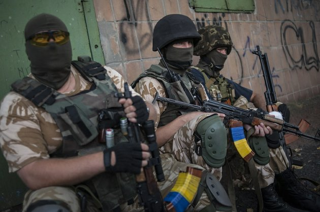 ukrainian-government-soldiers-from-battalion-donbass-rest-at-their-positions-in-village-mariinka-near-donetsk-eastern-ukraine-on-monday-aug-11-2014-the-red-cross-will-lead-an-international-humanitarian-aid-operation-into-ukraines-conflict-stricken-province-of-luhansk-with-assistance-from-russia-the-european-union-and-the-united-states-ukraine-said-monday