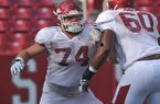 Arkansas offensive tackle Brey Cook runs a drill during practice Saturday, Aug. 9, 2014 at Razorback Stadium in Fayetteville.