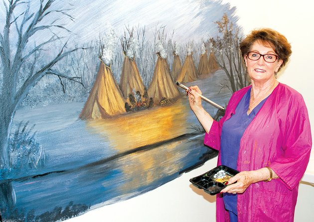 fairfield-bay-artist-doris-sexson-works-on-a-mural-inside-the-restroom-of-the-log-cabin-museum-at-the-indian-hills-country-club-in-fairfield-bay-the-mural-depicts-native-americans-and-their-tepees