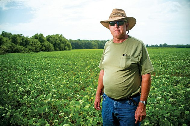 rj-peacock-a-farmer-who-cultivates-1600-acres-near-russell-stands-in-a-field-of-soybeans-that-are-several-weeks-behind-in-growth-because-of-recent-cool-wet-weather-he-has-lost-about-60-acres-of-crops-because-fields-have-been-underwater