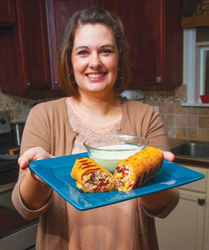 Tiffany Aaron of Quitman won first place in the 2014 Rice Expo Contest with her entry, Grilled Rice and Black Bean Burritos With Creamy Cilantro Dipping Sauce. She won $200, a rice cooker and a basket of Arkansas rice products.