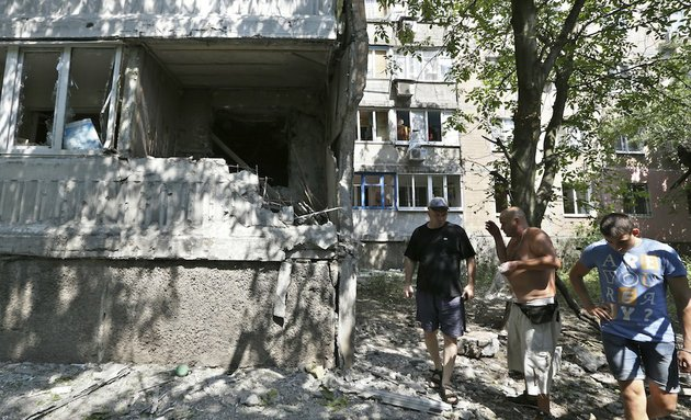residents-react-as-they-inspect-the-damage-after-shelling-in-donetsk-eastern-ukraine-on-wednesday-aug-13-2014-at-least-three-people-have-been-killed-in-the-separatist-controlled-city-of-donetsk-in-eastern-ukraine-as-the-government-intensifies-its-shelling-campaign