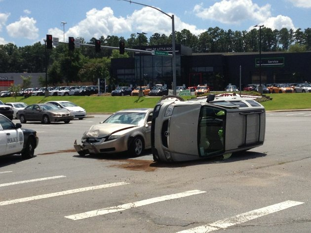 a-vehicle-rests-on-its-side-after-a-wreck-at-markham-street-and-chenal-parkway-in-little-rock-on-wednesday-aug-13-2014