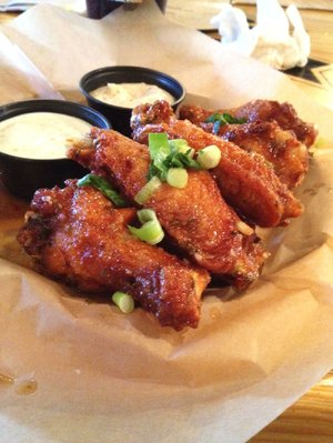 The Thai Chili Style Wings come with ranch and jalapeno aioli dips at Arkansas Ale House.