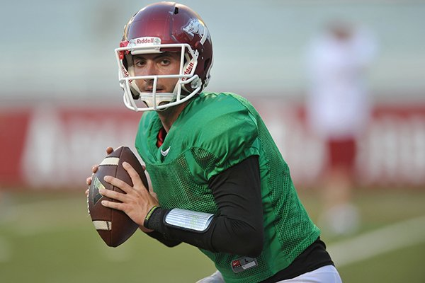 Arkansas quarterback Brandon Allen runs a drill during practice Wednesday, Aug. 13, 2014 at Razorback Stadium in Fayetteville.