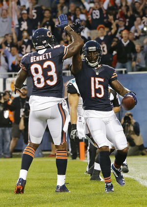 Chicago Bears wide receiver Brandon Marshall (15) celebrates his touchdown reception with teammate Martellus Bennett (83) during the first half of an NFL preseason football game against the Jacksonville Jaguars in Chicago, Thursday, Aug. 14, 2014. (AP Photo/Charles Rex Arbogast)