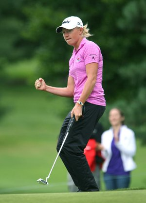 Stacy Lewis pumps her fist after putting on the 13th hole during the first round of the LPGA  Championship,Thursday, Aug. 14, 2014 at Monroe Golf Club in Pittsford, N.Y. (AP Photo/Democrat & Chronicle, Jamie Germano)  MAGS OUT; NO SALES