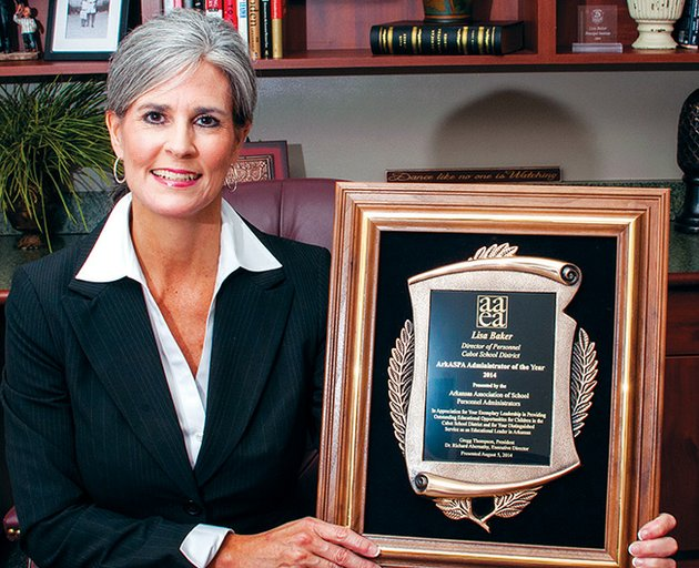 lisa-baker-director-of-personnel-for-the-cabot-public-schools-is-shown-in-her-office-holding-the-arkansas-school-personnel-administrator-of-the-year-award-from-the-arkansas-association-of-education-administrators