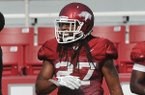 Arkansas safety Alan Turner goes through practice Saturday, Aug. 9, 2014 at Razorback Stadium in Fayetteville.