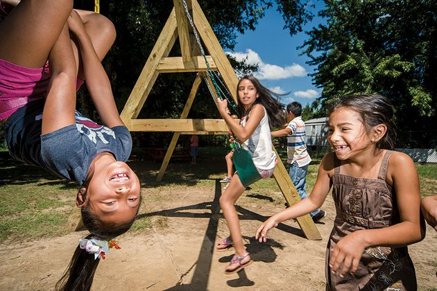 juliana-cruz-left-karla-rodriguez-center-and-brigett-trujillo-have-fun-on-the-swings-at-a-park-under-construction-in-the-brookside-village-mobile-home-community-in-conway-the-park-is-being-built-by-city-of-hope-outreach-and-its-partners-coho-a-nonprofit-ministry-offers-after-school-tutoring-and-bible-studies-for-students-and-english-as-a-second-language-classes-for-adults-in-the-mobile-home-park