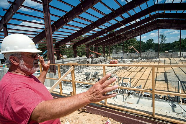 donald-rowlett-facilities-coordinator-for-the-quitman-school-district-talks-about-the-53-million-bulldog-complex-under-construction-by-moser-construction-of-bryant-the-facility-which-will-be-the-first-gym-built-in-the-district-since-the-1960s-is-scheduled-to-be-completed-in-may-2015-architects-for-the-project-are-lewis-elliott-mcmorran-vaden-ragsdale-and-woodward-of-little-rock-the-old-gym-will-be-used-for-elementary-physical-education-rowlett-said