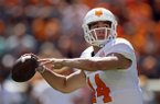 In this April 12, 2014, file photo, Tennessee quarterback Justin Worley throws to a receiver during the annual Orange and White NCAA college spring football game in Knoxville, Tenn. (AP Photo/Wade Payne, File)