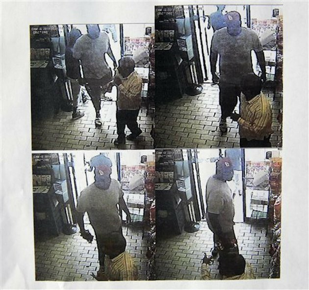these-images-provided-by-the-ferguson-police-department-show-security-camera-footage-from-a-convenience-store-in-ferguson-mo-on-aug-9-2014-the-day-that-michael-brown-was-fatally-shot-by-a-police-officer-a-report-released-friday-aug-15-2014-by-ferguson-police-chief-thomas-jackson-says-the-footage-shows-a-confrontation-between-brown-and-an-employee-at-the-store-the-report-says-that-brown-and-his-friend-dorian-johnson-stole-a-box-of-cigars-from-the-store-shortly-before-browns-death