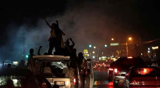 smoke-from-a-tire-burnout-rises-over-protestors-on-west-florissant-avenue-in-ferguson-on-friday-aug-15-2014