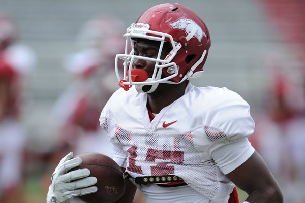 Arkansas freshman receiver Jojo Robinson catches a ball during practice Saturday, Aug. 16, 2014, at Razorback Stadium in Fayetteville.