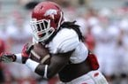 Arkansas sophomore running back Alex Collins carries the ball during practice Saturday, Aug. 16, 2014, at Razorback Stadium in Fayetteville.