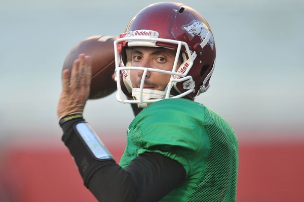Arkansas quarterback Brandon Allen runs drills during practice Wednesday, Aug. 13, 2014, at Razorback Stadium in Fayetteville.