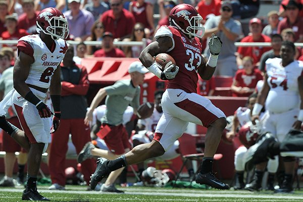 Arkansas running back Korliss Marshall runs for a touchdown during the Razorbacks' Red-White Game on Saturday, April 26, 2014 at Razorback Stadium.