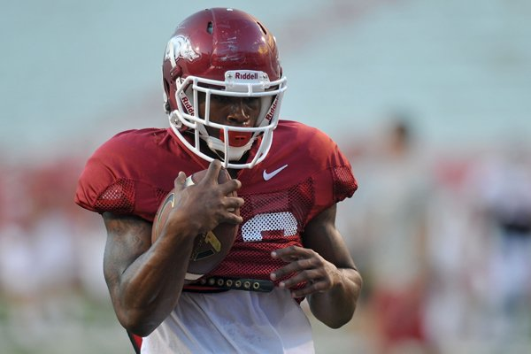 Arkansas defensive back Rohan Gaines runs drills during practice Wednesday, Aug. 13, 2014, at Razorback Stadium in Fayetteville.