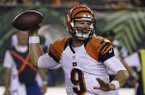 Cincinnati Bengals quarterback Tyler Wilson passes against the New York Jets in the second half of an NFL preseason football game, Saturday, Aug. 16, 2014, in Cincinnati. (AP Photo/Tony Tribble)