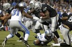 Oakland Raiders running back Darren McFadden (20) runs against Detroit Lions cornerback Rashean Mathis (31) during the second quarter of an NFL preseason football game in Oakland, Calif., Friday, Aug. 15, 2014. (AP Photo/Marcio Jose Sanchez)