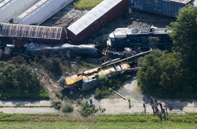 arkansas-democrat-gazettemelissa-sue-gerrits-08172014-workers-respond-to-the-aftermath-of-a-3am-head-on-collision-of-2-union-pacific-trains-outside-of-hoxie-in-lawrence-county-august-17-2014-2-individuals-were-killed-and-2-reported-injured-all-believed-to-be-among-the-crews-onboard-the-freight-trains-due-to-toxic-chemical-cargo-some-members-of-hoxie-were-evacuated-and-directed-to-the-walnut-ridge-community-center-all-highways-leading-into-hoxie-were-blocked-by-arkansas-state-police-and-local-law-enforcement-personnel-directing-individuals-to-hwy-91-east-of-hoxie