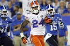 In this Sept. 28, 2013, file photo, Florida running back Matt Jones (24) outruns Kentucky's TraVaughn Paschal, left, and Marcus McWilson (15) in the second quarter of an NCAA college football game in Lexington, Ky. (AP Photo/James Crisp, File)