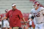 Arkansas coach Bret Bielema talks with center Frank Ragnow during a practice on Wednesday, Aug. 13, 2014 at Razorback Stadium in Fayetteville.