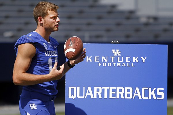 In this Aug. 5, 2013, file photo, Kentucky NCAA college football quarterback Patrick Towles waits to be interviewed during media day at Commonwealth Stadium in Lexington, Ky. (AP Photo/James Crisp, File)