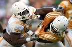 Tennessee offensive lineman Jashon Robertson (73), left, overpowers Tennessee linebacker Jalen Reeves-Maybin (34), right, during Tennessee's open practice at Neyland Stadium in Knoxville on Saturday, Aug. 16, 2014. (AP Photo/Knoxville News Sentinel, Adam Lau)