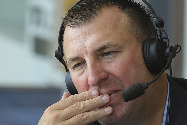 Arkansas football coach Bret Bielema does a radio interview Tuesday, Aug. 19, 2014 before speaking at the opening week of the little Rock Touchdown Club.