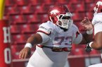 Arkansas offensive guard Sebastian Tretola goes through drills during practice on Saturday, Aug. 9, 2014 at Razorback Stadium in Fayetteville.