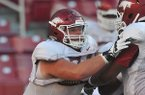 Arkansas offensive tackle Brey Cook goes through drills during practice on Wednesday, Aug. 13, 2014 at Razorback Stadium in Fayetteville.