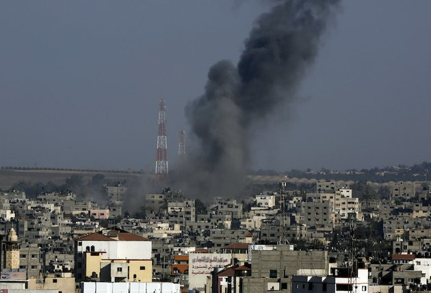 smoke-rises-after-an-israeli-strike-hit-gaza-city-in-the-northern-gaza-strip-on-tuesday-aug-19-2014-the-israeli-military-said-it-carried-out-a-series-of-airstrikes-tuesday-across-the-gaza-strip-in-response-to-renewed-rocket-fire-a-burst-of-violence-that-broke-a-temporary-cease-fire-and-endangered-negotiations-in-egypt-over-ending-the-month-long-war-between-israel-and-hamas-the-fighting-occurred-some-eight-hours-before-a-temporary-truce-was-set-to-expire