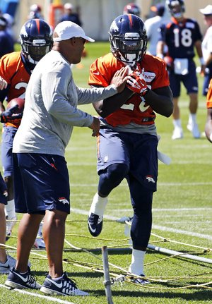 Denver running back Montee Ball goes through drills Tuesday after returning to camp in Englewood, Colo.