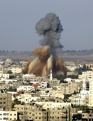 Smoke and debris rise after an Israeli strike hit Gaza City in the northern Gaza Strip on Tuesday.