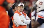 Auburn coach Gus Malzahn, center, watches the first half of an NCAA college football game against Arkansas in Fayetteville, Ark., Saturday, Nov. 2, 2013. (AP Photo/Danny Johnston)