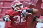 Arkansas running back Jonathan Williams runs a drill during practice on Saturday, April 12, 2014 at Razorback Stadium in Fayetteville.
